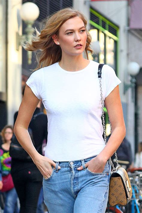 Karlie Kloss in Boyfriend Jeans and Tan Hiking Boots 4/12/2017
