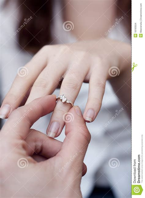 Engagement Ring Into A Finger Stock Photo - Image of