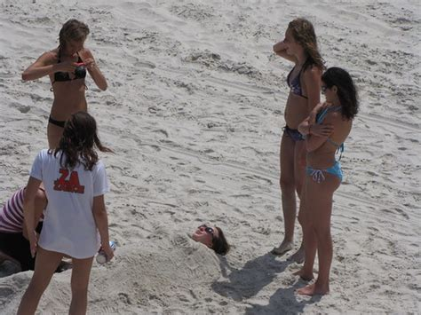 The girls at Daytona Beach burying their dead - a photo on